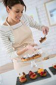 Baker serving piece of tart to customer