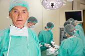 Medical professor looking at camera during fake surgery at the university