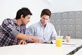 Two Men Working Together In Design Studio