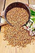 stock photo of buckwheat  - Buckwheat in a bowl on the table - JPG