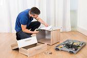 Carpenter Assembling Furniture