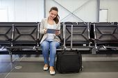 Businesswoman Using Digital Tablet At Airport Lobby