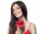 closeup portrait of attractive  caucasian smiling woman brunette isolated on white studio shot lips toothy smile face hair head and shoulders looking at camera tooth red rose flower body care