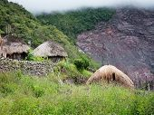 Traditional hut in  village. New Guinea