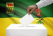 Voting Concept - Ballot Box With Canadian Province Flag On Background - Saskatchewan
