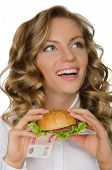 Young Woman With Hamburger From Rur Looking Away