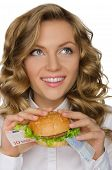 Young Woman With Hamburger From Euro Looking Away