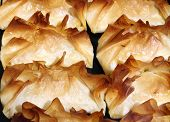 stock photo of phyllo dough  - Sweet cakes of filo dough with filling - JPG