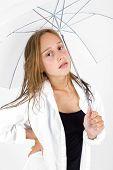 Girl Poses With Umbrella In Studio