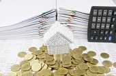 House On Stack Silver And Gold Coins