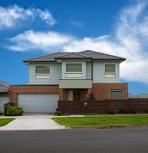 stock photo of suburban city  - typical Australian modern house close up on summer - JPG