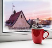 Red Cup Of Coffee On The Windowsill