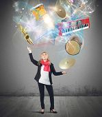 image of juggler  - Woman plays with instruments like a juggler - JPG