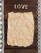 Old Paper And Word  Love On The Wood Background