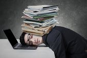 Exhausted Man With Paperwork On His Head