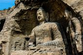picture of grotto  - A very big Bodhisattva sitting in a cave  in Yunmen grotto - JPG