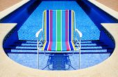 Swimming Pool And Deckchair