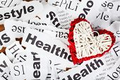 Decorative wicker  heart on background of paper notes