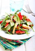 stock photo of rocket salad  - Rocket chicken red bell pepper and cucumber salad with vinaigrette dressing - JPG