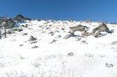 Snowy mountain rock ridge