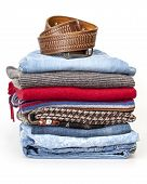 A woolen jumpers and jeans of various shades