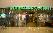 SHENZHEN, CHINA - JAN 06: Starbucks Cafe entrance on January 06, 2015. Starbucks Corporation is an American global coffee company and coffeehouse chain based in Seattle, Washington