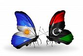 stock photo of libya  - Two butterflies with flags on wings as symbol of relations Argentina and Libya - JPG