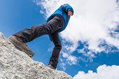 Female Walking On Mountain Ridge