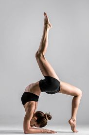 pic of elbow  - Beautiful sporty yogi girl practices yoga asana handstand with bending standing on forearms standing on elbows - JPG