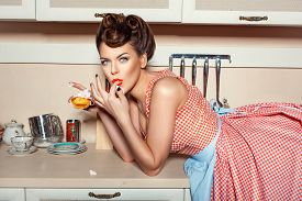 stock photo of finger-licking  - Girl eating cake and licking her fingers she was lying on the table - JPG