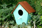 pic of nesting box  - Decorative nesting box on green background - JPG
