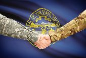 pic of nebraska  - Soldiers handshake and US state flag  - JPG