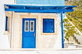 foto of windows doors  - Wooden blue doors and windows with shade from roofing typical for Greek islands - JPG