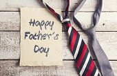 pic of backround  - Happy fathers day sign on paper and colorful ties laid on wooden floor backround - JPG