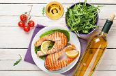 picture of salmon steak  - Grilled salmon and white wine on wooden table - JPG