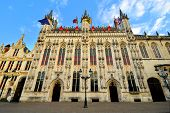 foto of city hall  - Beautiful architecture of Bruges City Hall upward view at dusk Belgium - JPG