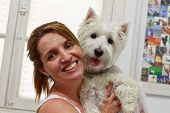 picture of westie  - Happy Brazilian woman owner of her West Higland White Terrier dog - JPG
