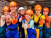 image of millwright  - Group people in blue builder uniform thumb up - JPG