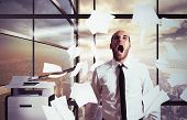 foto of yell  - Businessman stressed and overworked yelling in office - JPG