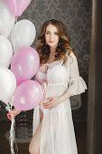stock photo of fondling  - Beautiful young pregnant woman - JPG