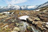 image of mountain-range  - Little mountain streams from melting snow flowing in idyllic uncontaminated environment - JPG
