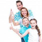 pic of european  - Portrait of the happy european family with children shows the thumbs up sign  - JPG