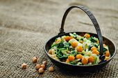 picture of chickpea  - chickpeas and spinach curry on a dark background - JPG