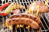foto of grilled sausage  - Sausage pork and chop steak on a flaming BBQ grill - JPG