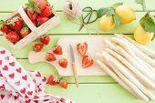 pic of white asparagus  - White asparagus and fresh strawberries in early summer season - JPG