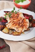 stock photo of chicken  - Grilled chicken steak with roasted potato and vegetables on wooden table - JPG