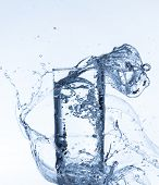 image of freeze  - Fresh drink with splashing stream of water shot on freeze motion - JPG