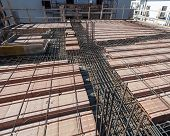 stock photo of reinforcing  - Reinforce iron cage net for built building floor in construction site - JPG