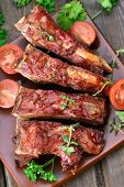 stock photo of ribs  - Pork ribs on the plate top view - JPG