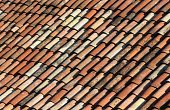 image of unicity  - Old tiles of different colors on a mediterranean roof - JPG